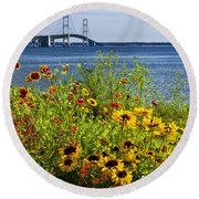 Blooming Flowers By The Bridge At The Straits Of Mackinac Round Beach Towel by Randall Nyhof