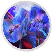 Round Beach Towel featuring the mixed media Blue Poppies On Red by Carol Cavalaris