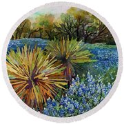 Round Beach Towel featuring the painting Bluebonnets And Yucca by Hailey E Herrera