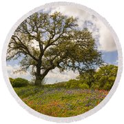 Bluebonnets Paintbrush And An Old Oak Tree - Texas Hill Country Round Beach Towel