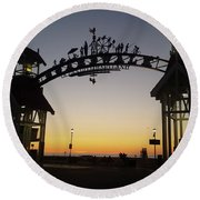 Round Beach Towel featuring the photograph Boardwalk Arch At Dawn by Robert Banach