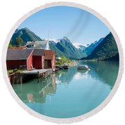 Round Beach Towel featuring the photograph Boathouse With Mountains And Reflection In The Fjord In Norway by IPics Photography