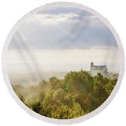 Round Beach Towel featuring the photograph Bobolice Castle In The Morning Haze by Dmytro Korol