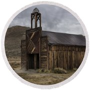 Round Beach Towel featuring the photograph Bodie Fire Station With Lightning by Sandra Bronstein