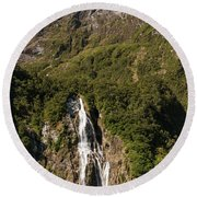 Round Beach Towel featuring the photograph Bowen Falls Milford Sound by Gary Eason
