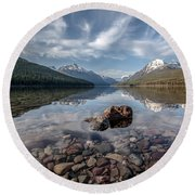 Bowman Lake Rocks Round Beach Towel by Aaron Aldrich