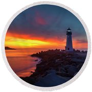Break Of Day At Walton Lighthouse Round Beach Towel