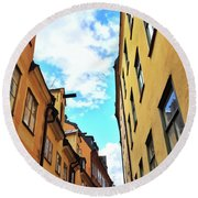 Bright Buildings In The Old Center Of Stockholm Round Beach Towel