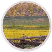 Broken Wagon In A Field Of Flowers Round Beach Towel