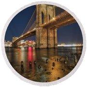 Round Beach Towel featuring the photograph Brooklyn Bridge At Night by Mark Dodd