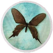 Brown Butterfly Over Blue Textured Background Round Beach Towel