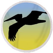 Brown Pelican In Flight Silhouette At Sunrise Round Beach Towel