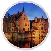 Round Beach Towel featuring the photograph Bruges Architecture At Blue Hour by Barry O Carroll