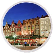 Round Beach Towel featuring the photograph Cafes And Restaurants On Markt Square - Bruges by Barry O Carroll