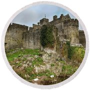 Round Beach Towel featuring the photograph Cahir Castle by Marie Leslie