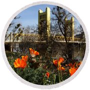 California Poppies With The Slightly Photographically Blurred Sacramento Tower Bridge In The Back Round Beach Towel