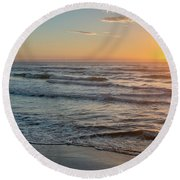 Calm Water Over Wet Sand During Sunrise Round Beach Towel