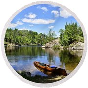 Canoe At The Portage Landing -- Slim Lake Round Beach Towel