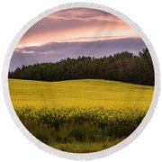 Round Beach Towel featuring the photograph Canola Crop Sunset by Darcy Michaelchuk