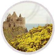Round Beach Towel featuring the photograph Castle Ruins And Yellow Wildflowers Along The Irish Coast by Juli Scalzi