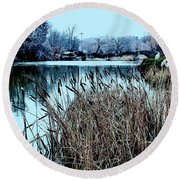 Round Beach Towel featuring the photograph Cattails On The Water by Sandy Moulder