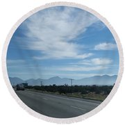 Changing Lanes On A Desert Highway Round Beach Towel