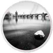 Charles Bridge During Winter Time With Frozen River, Prague, Czech Republic Round Beach Towel