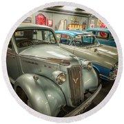 Round Beach Towel featuring the photograph Classic Car Memorabilia by Adrian Evans