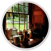 Round Beach Towel featuring the photograph Clay Jars On Windowsill by Susan Savad