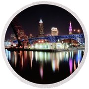Round Beach Towel featuring the photograph Cleveland Ohio Lights Up With Color by Frozen in Time Fine Art Photography