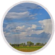 Clouds Aboive The Tree Farm Round Beach Towel