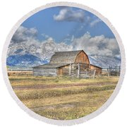 Clouds And Barn Round Beach Towel