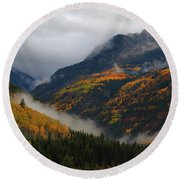 Round Beach Towel featuring the photograph Clouds And Fog Encompass Autumn At Mcclure Pass In Colorado by Jetson Nguyen