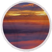 Clouds Of Fire Surround The La Sal Mountains From Dead Horse Point State Park Round Beach Towel
