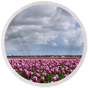 Clouds Over Purple Tulips Round Beach Towel