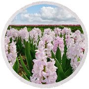 Clouds Over The Pink Hyacinth Field Round Beach Towel