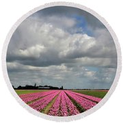 Clouds Over The Purple Tulip Field Round Beach Towel by Mihaela Pater