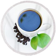 Coffee Sitting On Saucer Plate With Coffee Beans And Green Leaves Round Beach Towel