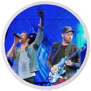 Coldplay6 Round Beach Towel by Rafa Rivas