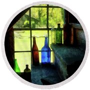 Round Beach Towel featuring the photograph Colored Bottles On Steps by Susan Savad