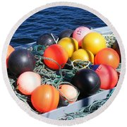 Round Beach Towel featuring the photograph Colorful Buoys by Barbara Griffin