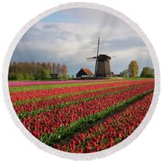 Round Beach Towel featuring the photograph Colorful Rows Of Tulips In Front Of A Windmill by IPics Photography
