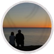 Round Beach Towel featuring the photograph Couple Silhouettes By Sunset by Kennerth and Birgitta Kullman