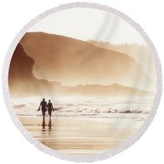 Couple Walking On Beach With Fog Round Beach Towel