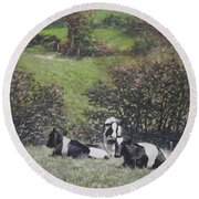 Round Beach Towel featuring the painting Cows Sitting By Hill Relaxing by Martin Davey