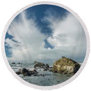 Crescent City Coast And Clouds Round Beach Towel by Greg Nyquist