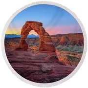 Round Beach Towel featuring the photograph Dawn At Delicate Arch by Rick Berk