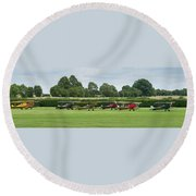 Round Beach Towel featuring the photograph De Havilland Tiger Moths Line-up by Gary Eason