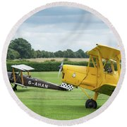 Round Beach Towel featuring the photograph De Havilland Tiger Moths Taxiing by Gary Eason