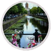 Round Beach Towel featuring the photograph Canal And Decorated Bike In The Hague by RicardMN Photography